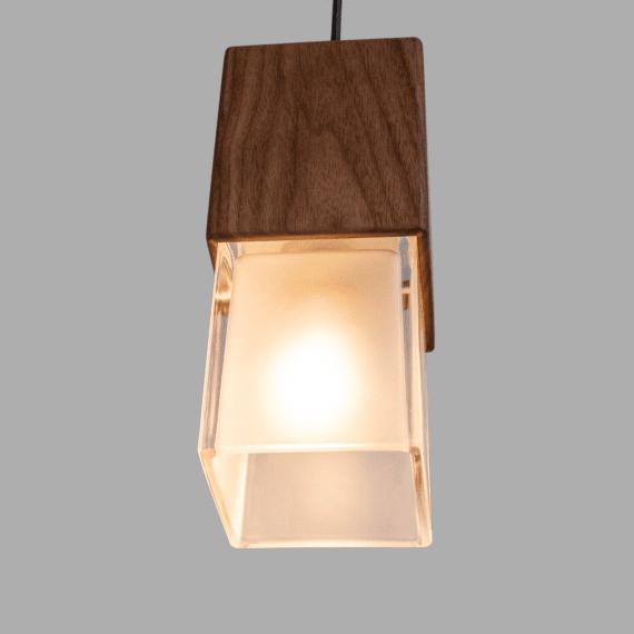 prairie pendant light, lit up, thick glass and walnut wood