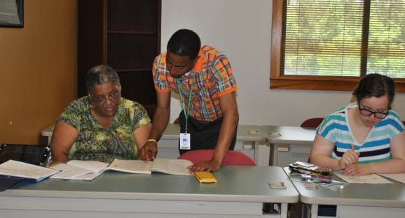 Adult Education instructor, RaShaun Tanner working with a student on an assignment during one of OFTC's Adult Education & GED classes in Sandersville.