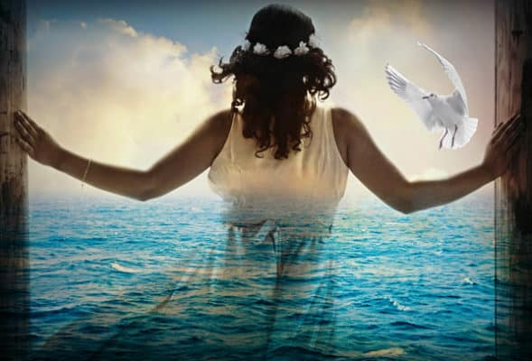 Woman in water with dove