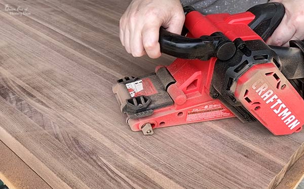 flattening wood with belt sander
