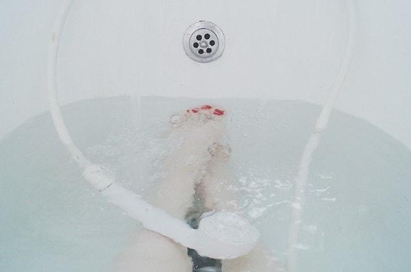 Using Body Scrubber in Bath