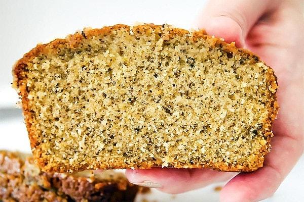 Holding slice of Earl Grey loaf