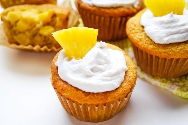Piña Colada cupcakes with whipped coconut cream and pineapple wedge topping