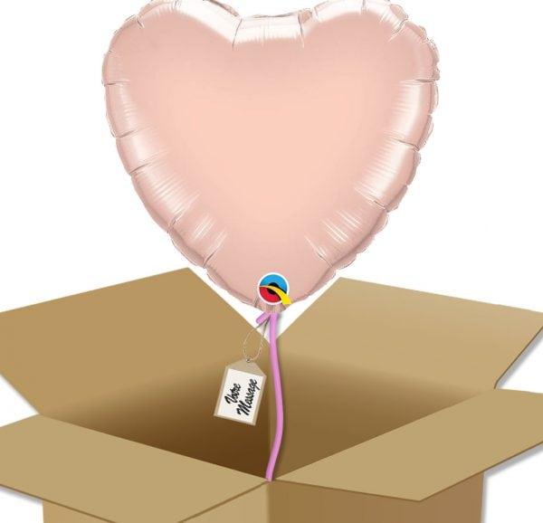 Ballon amour rose gold dans sa boîte.