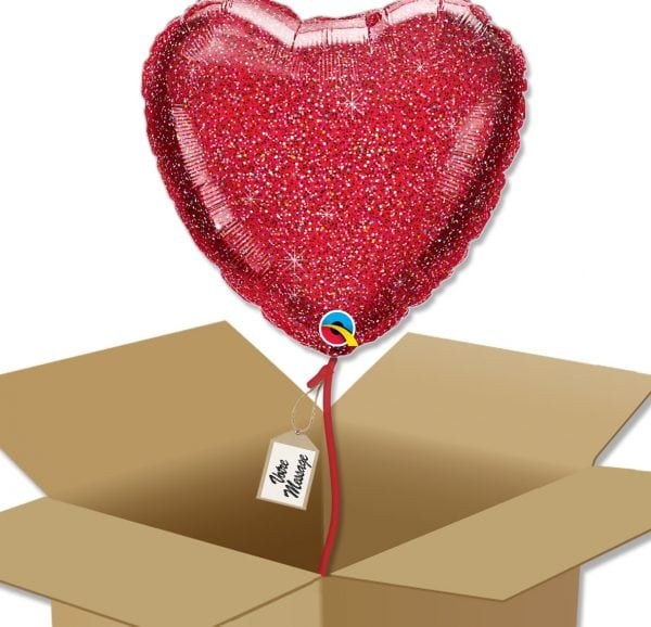 Ballon coeur rouge pailleté dans sa boîte.