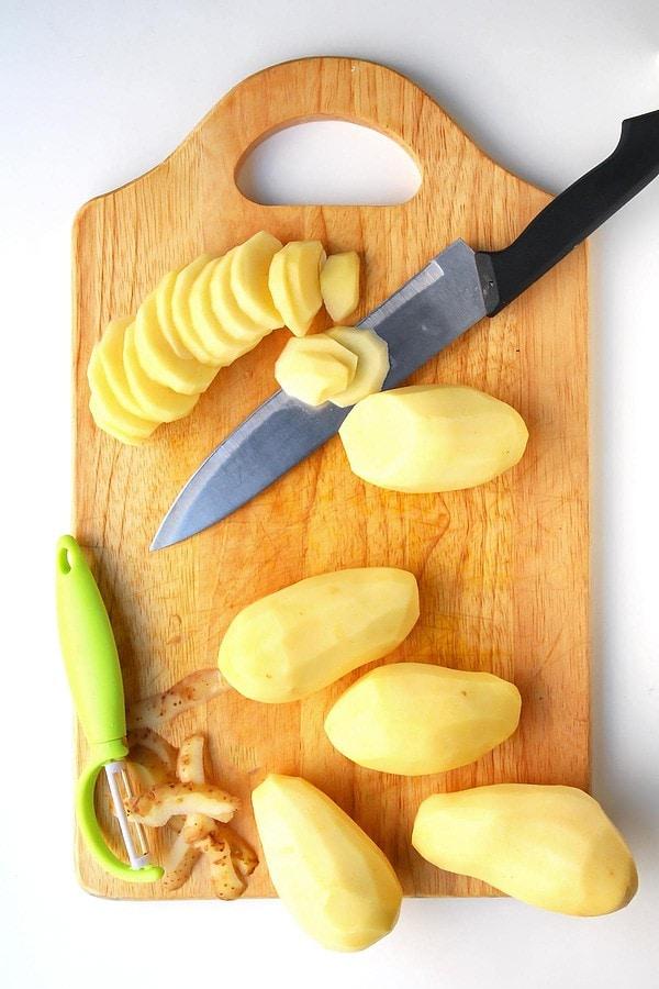Slicing Potatoes on Cutting Board