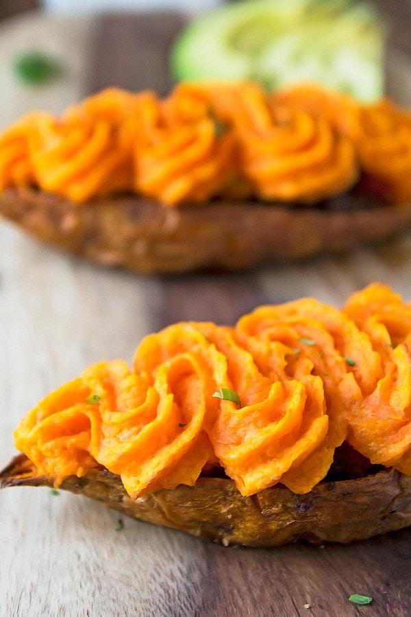 Stuffed sweet potatoes with piped swirls of mash