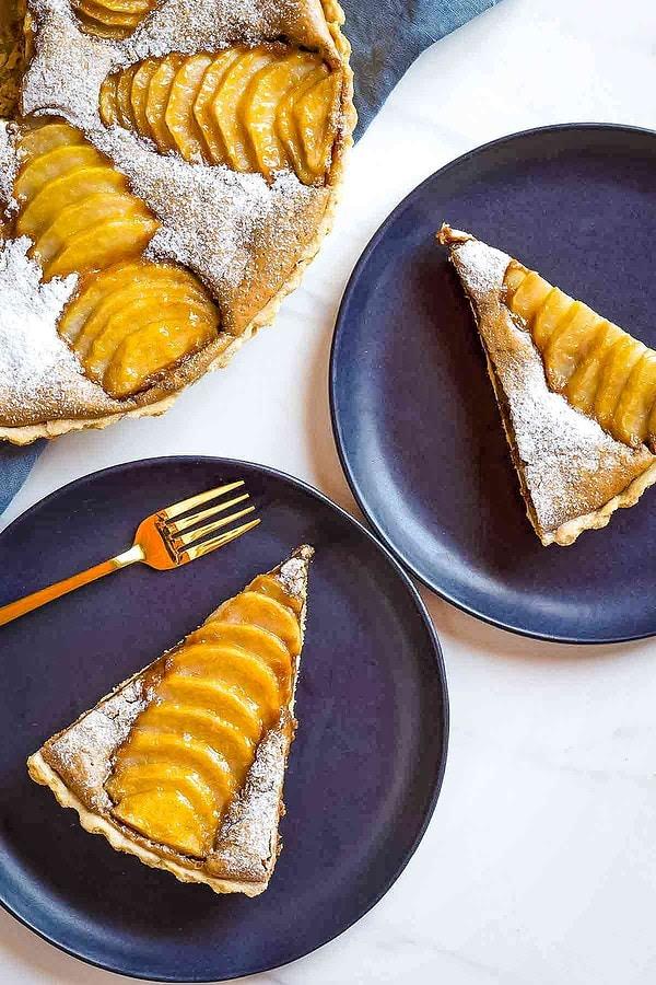 2 Almond Pear Tart slices on black plates