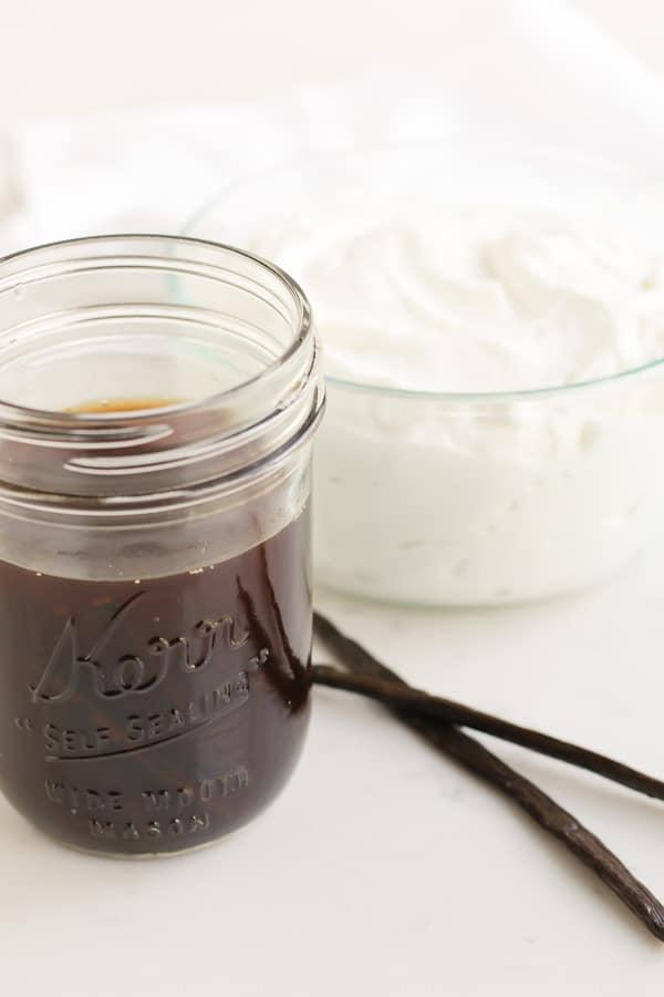 mason jar of vanilla extract and bowl of yogurt