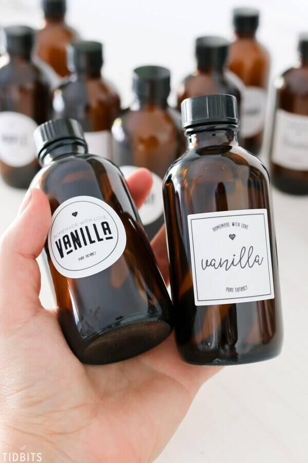 bottles of vanilla extract held in hands