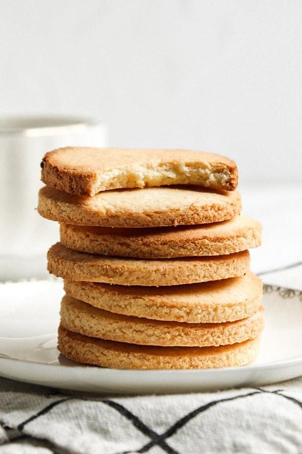 Stack of paleo sugar cookies. Top one is bitten off