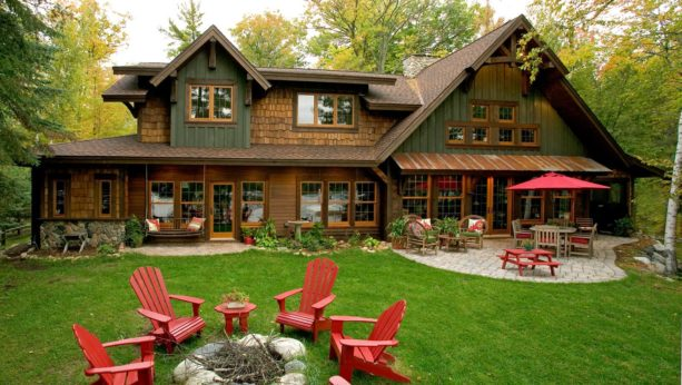 rustic exterior green house with light brown trim