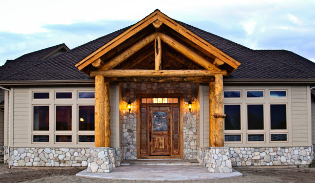 front entry door from stained wood material for a rustic-style house