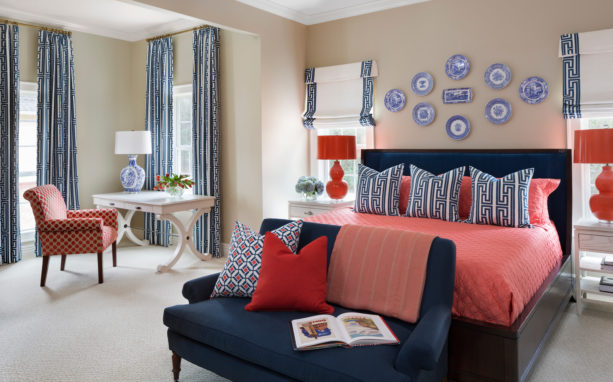 a relaxing sensation in a transitional bedroom with coral, navy and khaki colors