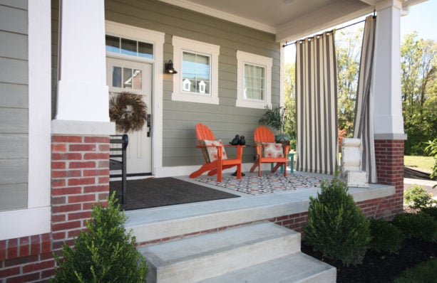 a simple-looking front door trim that complements the window casing