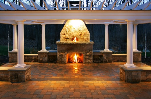 united but separated stone surround outdoor fireplace and pizza oven