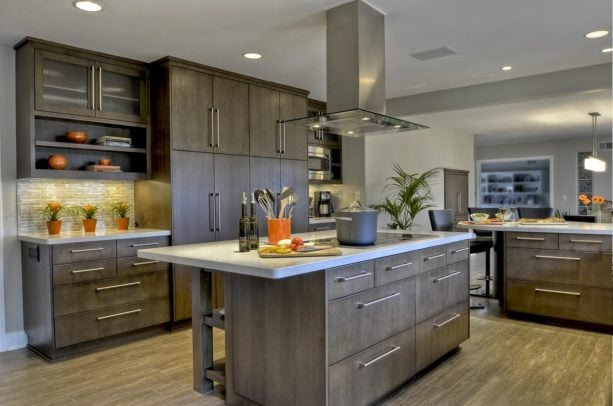 slab floor to ceiling cabinets with sleek stainless steel handles