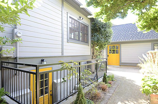bright yellow dutch walkout basement door option for a fun element in the exterior
