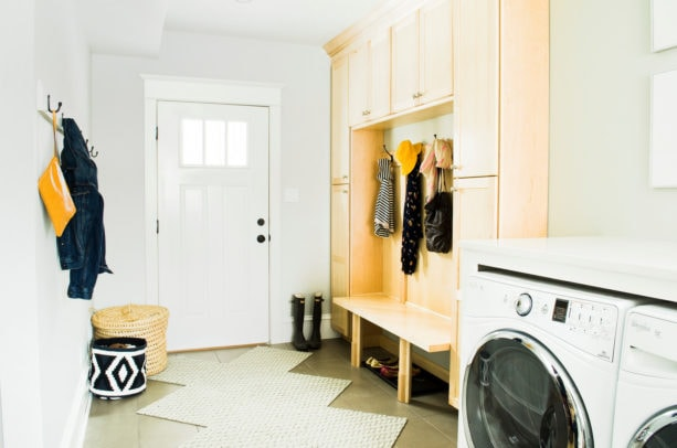 combination of ceramic tiles and carpet tile in a laundry room floor for an aesthetic look
