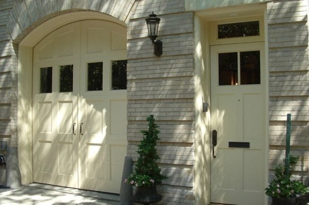 a custom front door with transom that matches the garage door style
