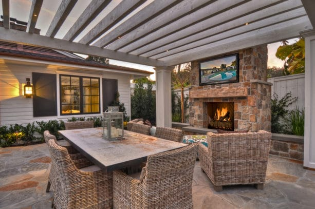 transitional stone patio and fireplace completed with a flat screen tv