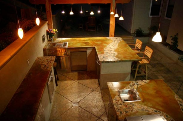 tropical l-shaped outdoor kitchen with balinese style and decorative concrete
