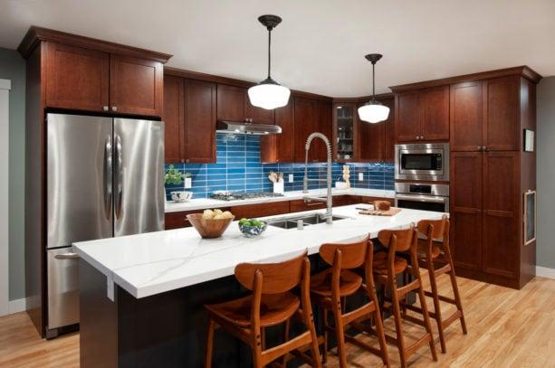 unique combination of blue backsplash kitchen color and dark brown shaker cabinets to give a calming sensation