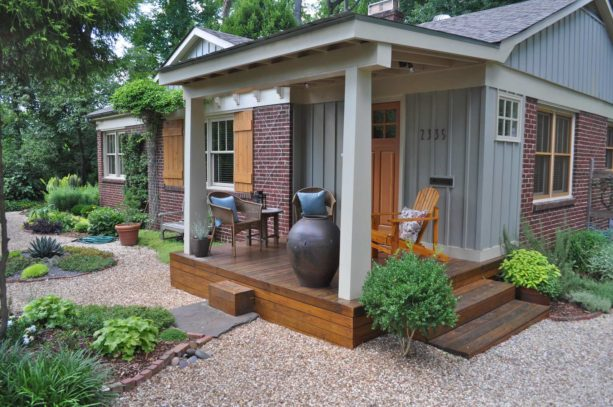 tiny front porch with decking and seating area in a ranch style home