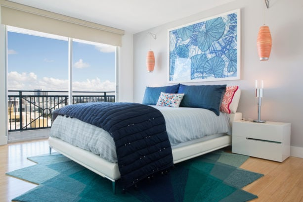 a balanced and sophisticated contemporary bedroom with coral, navy blue, and white color scheme