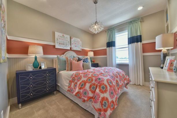 a traditional bedroom with cozy atmosphere from coral, indigo blue, and beige color combination