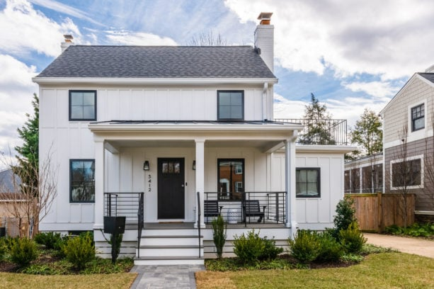 accentuating black trim in a transitional white house