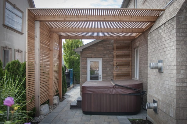 wooden slat privacy screen that also works as cover