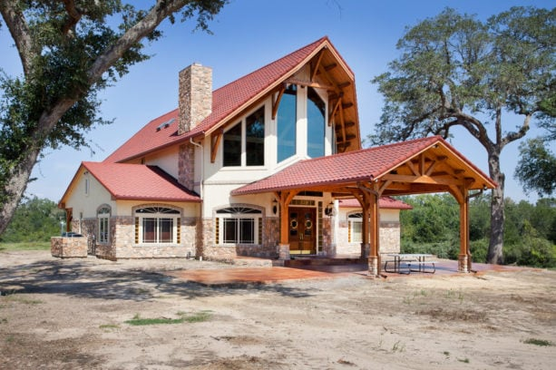 timber frame post and beam carport in a mountain style house exterior