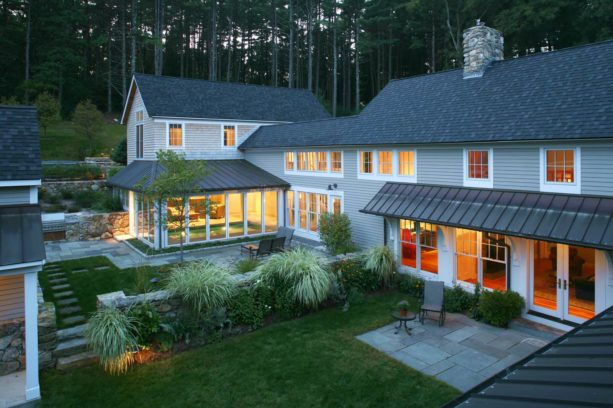 asphalt and copper metal roof color combination in a stained clapboard siding house