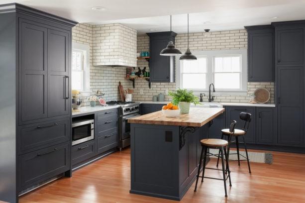 blue gray shaker kitchen cabinets with beige backsplash