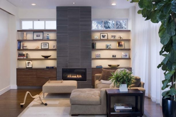 contemporary living room with a tile fireplace in a bookshelves wall unit