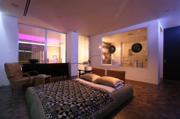 contemporary platform bed in the middle of a trendy modern room