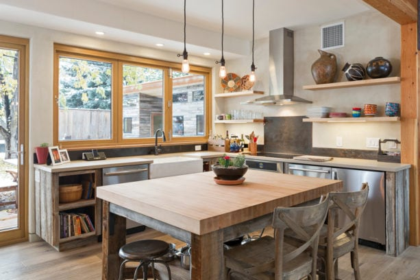 countertop folding windows over a farmhouse sink in a u-shaped kitchen