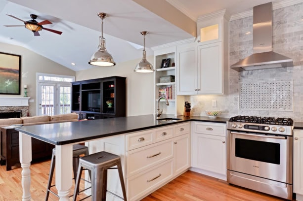 dark quartzite countertops kitchen peninsula with industrial counter stools seating