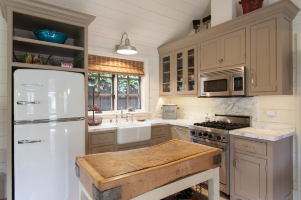 double hung windows over a farmhouse sink in a small kitchen