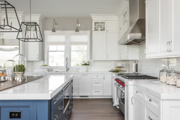 double hung windows over undermount sink in an l-shaped kitchen