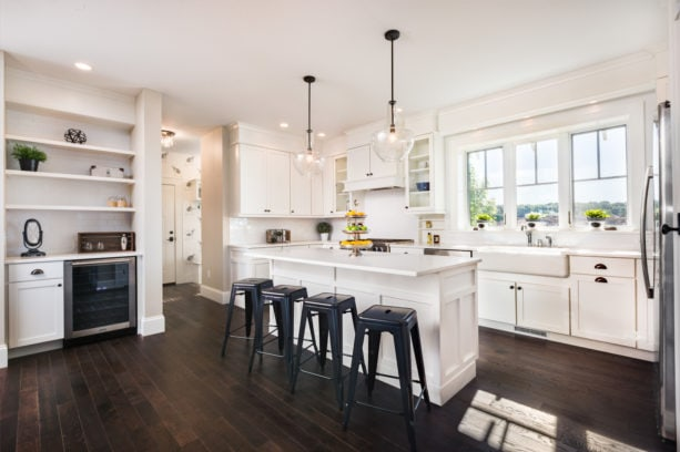 large single-hung windows with deep sill over a farmhouse sink in an open kitchen