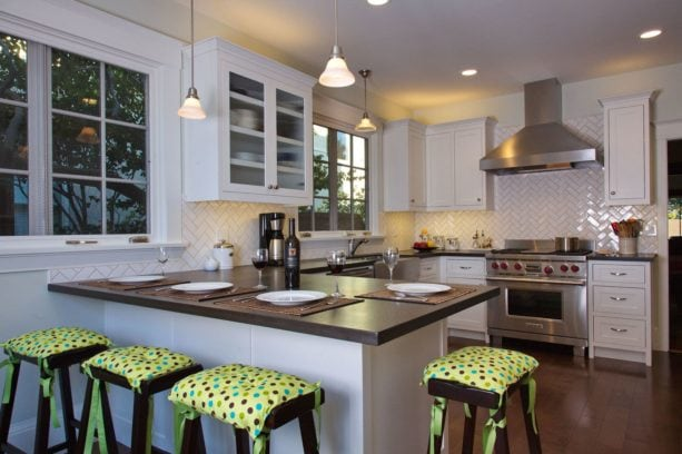 paper stone countertops kitchen peninsula with covered wood barstools seating