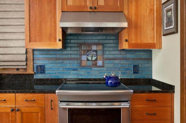 tile mural backsplash only behind stove in a craftsman kitchen