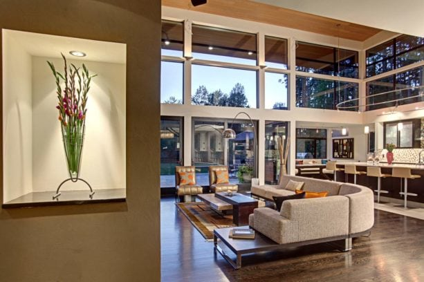 combo contemporary kitchen and urban style living room with white walls