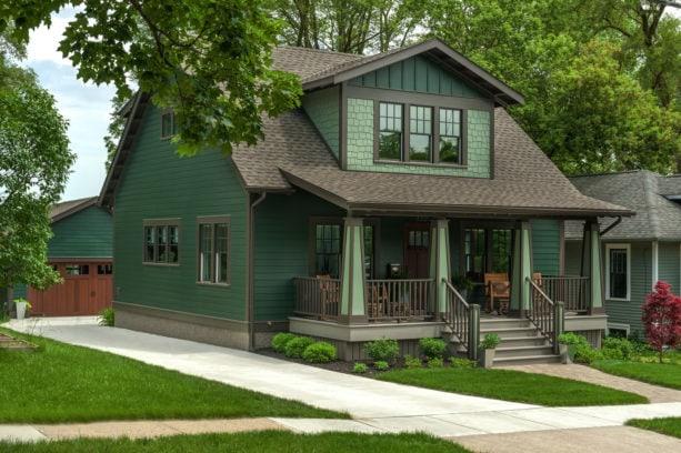 craftsman style green house with dark brown trim