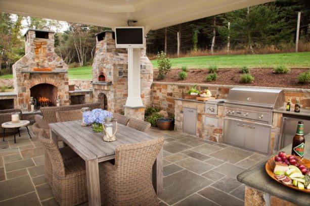 l-shaped bucks county blend stone fireplace and a pizza oven