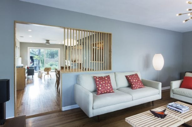 mid-century living room with white oak vertical wood slat wall