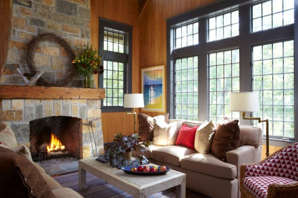 mid-century modern standard fireplace made from native alabama stone and reclaimed wood mantel