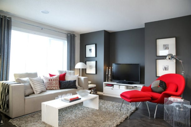a set of bright red chair and ottoman for creating a focal point in grey living room